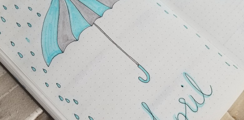 April 2019 Cover Page with Umbrella and Rain Drops - April 2019 Bullet Journal Setup