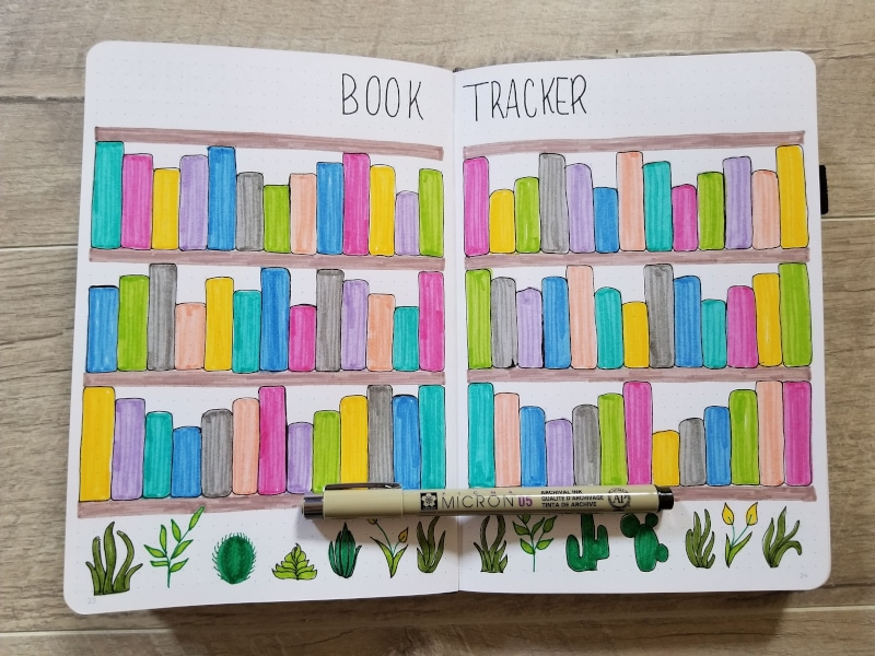 Bullet Journal Book Tracker with hand drawn bookshelf and plants