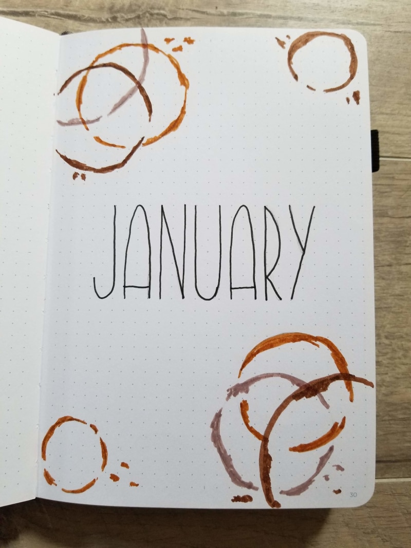 Bullet Journal Cover Page For January With Coffee Rings For A Coffee Theme