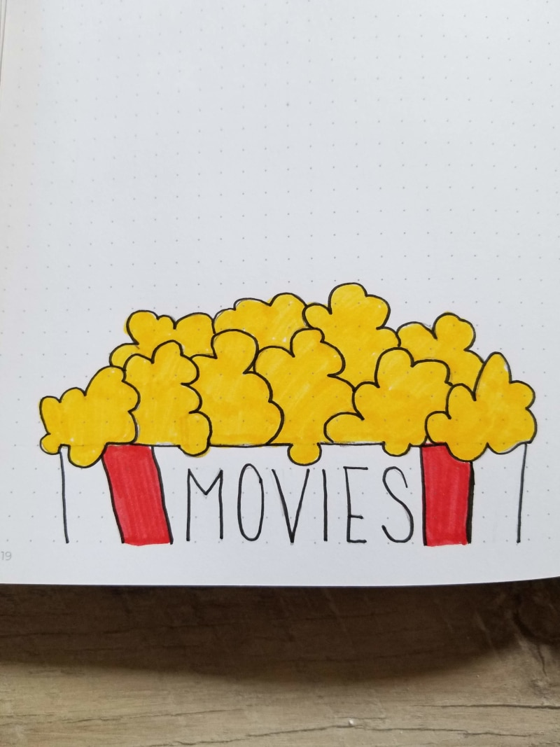 Bullet Journal Movies Spread With Hand Drawn Popcorn and Bag